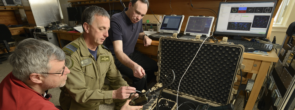 slide - Department of National Defence, Canadian Armed Forces and Defence Research and Development Canada (DRDC) personnel test over-the-air distribution (OTAD) of GPS encryption keys at DRDC Ottawa Research Centre's navigation warfare lab.